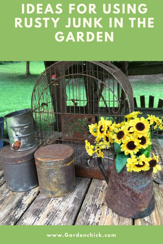 Rusty garden containers look great with the fall colors of orange and yellow. They stand out against the brown rusty color