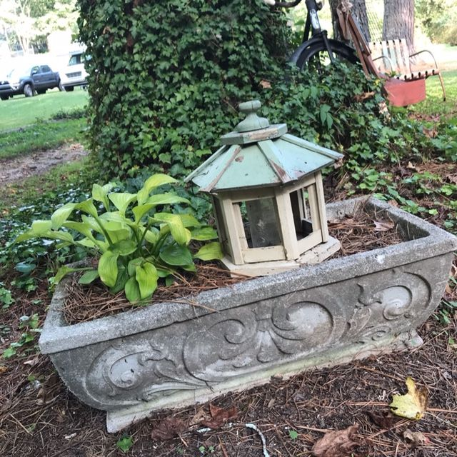 Concrete planter with vintage bird feeder