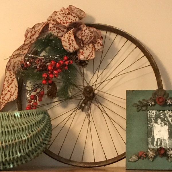 Add a flea market touch to your Christmas decor using an old bicycle wheel with greenery added