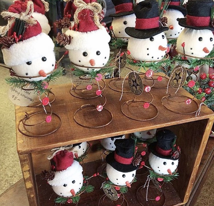 Create a fun snowman decoration using a rusty spring and snowman head ornament
