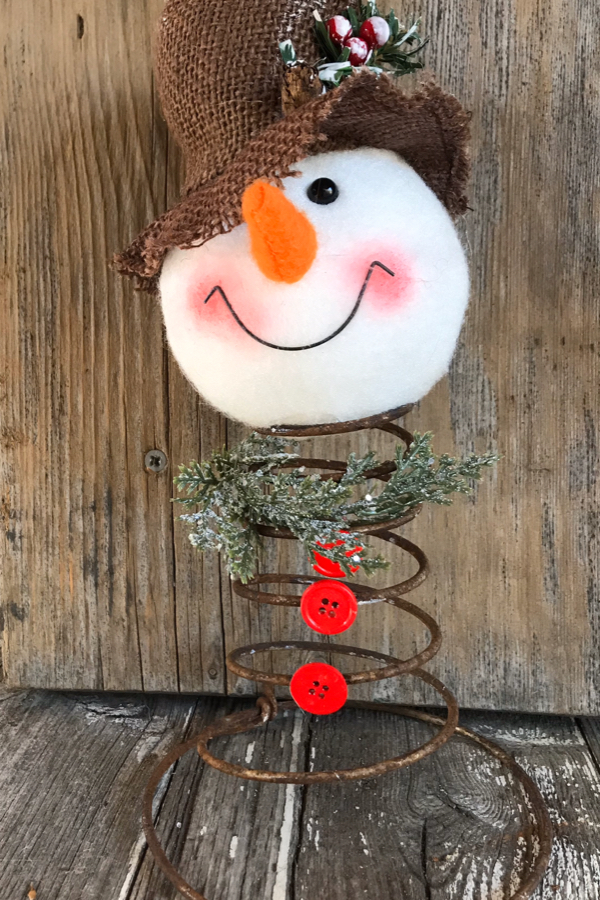 Repurpose an old bedspring into a snowman