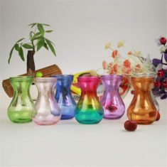 Colored vases shaped like an hour glass for forcing bulbs.